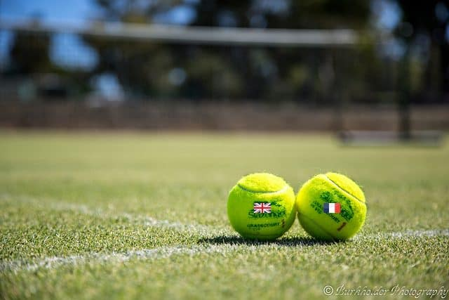 tennis ball with english and french flags